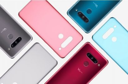 Three LG V40 ThinQs face down on a table with back cases positioned in a brick pattern.