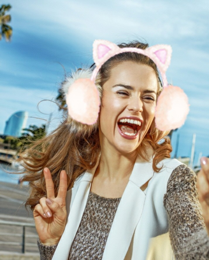 """The other woman's selfie, her face is decorated by """"the cat ear warmer"""" AR sticker."""