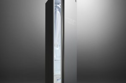 LG Styler with Black Tinted Mirror Glass Door slightly open to show a white collared shirt hanging inside