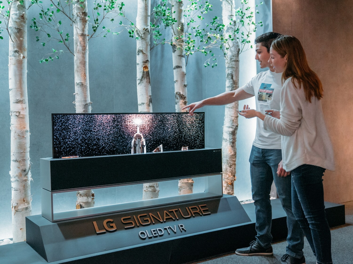 Models pose with LG SIGNATURE OLED TV R.
