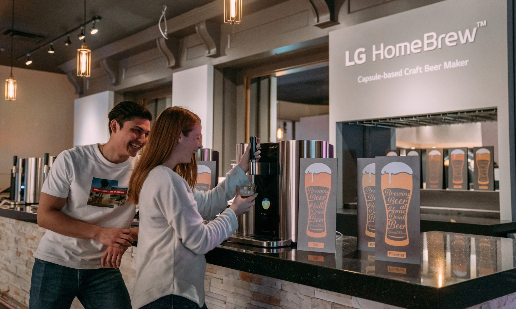 Models pose with LG HomeBrew, the innovative capsule-based device to make craft beer.