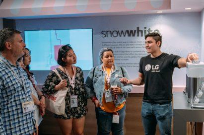 One LG staff member explains LG's personal ice cream maker prototype, snowwhite.