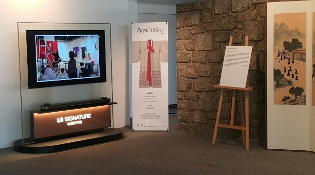 "The LG SIGNATURE OLED TV W and promotional banners form a display that introduces Korea's traditional ""chasu"" embroidery."