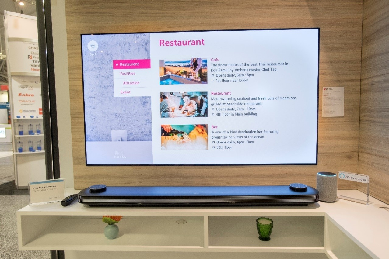 The LG SIGNATURE OLED TV W's screen displays restaurant recommendations offered by the Alexa for Hospitality platform.