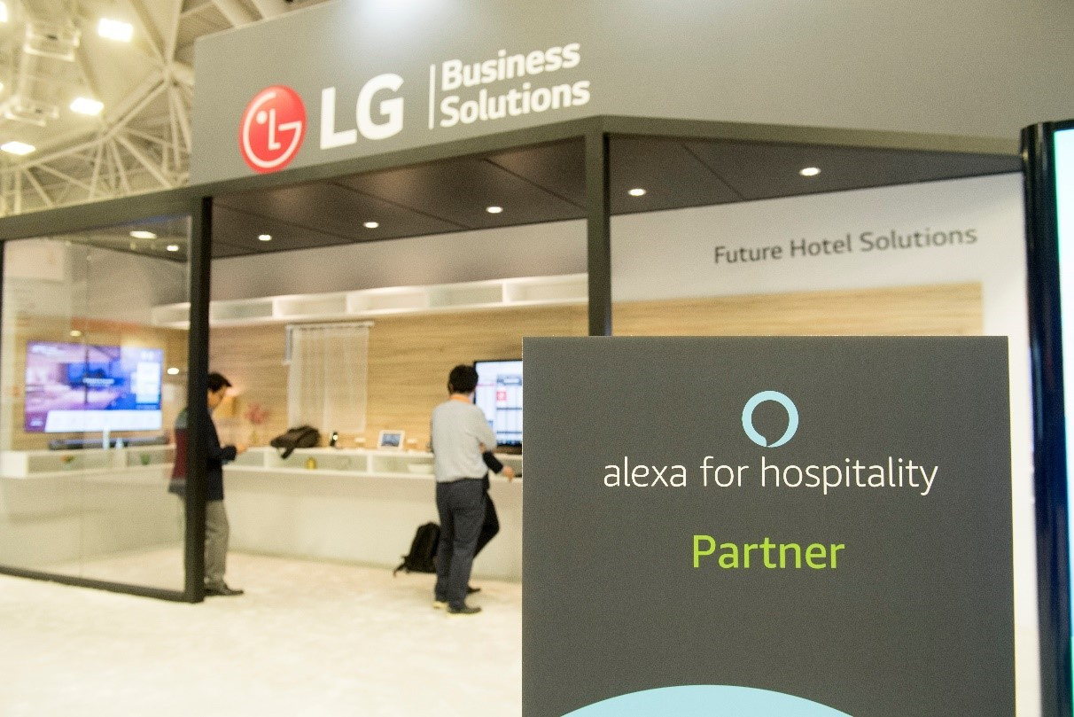 """The outside of LG's booth at the Hospitality Industry Technology Exposition and Conference, with a sign saying LG is an """"Alexa for Hospitality Partner."""""""