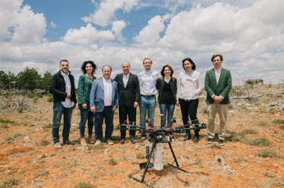 The associates of LG Smart Green project stand together behind the drone which is equipped with the LG G8S ThinQ smartphone.