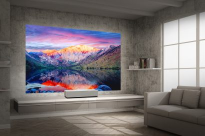A view of LG CineBeam 4K UHD projector model HU85L producing incredible natural landscapes in a modern, low-lit living room