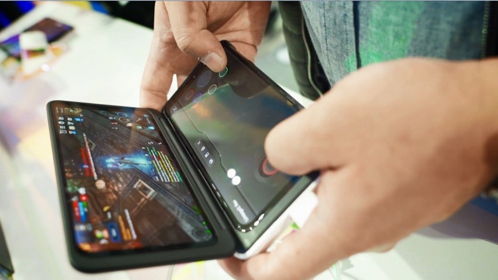 A man holds the LG G8X ThinQ Dual Screen to play a mobile game.