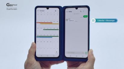 The LG G8X ThinQ with Dual Screen held up with two hands while displaying the calendar on screen, and the text application on the other simultaneously.