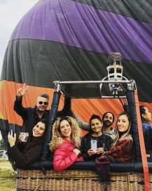 A group of influencers pose with their LG smartphones while in a hot-air balloon right before taking off.