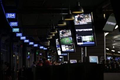 A far shot of one of Topgolf venues which shows visual content on LG's commercial digital signage solutions.