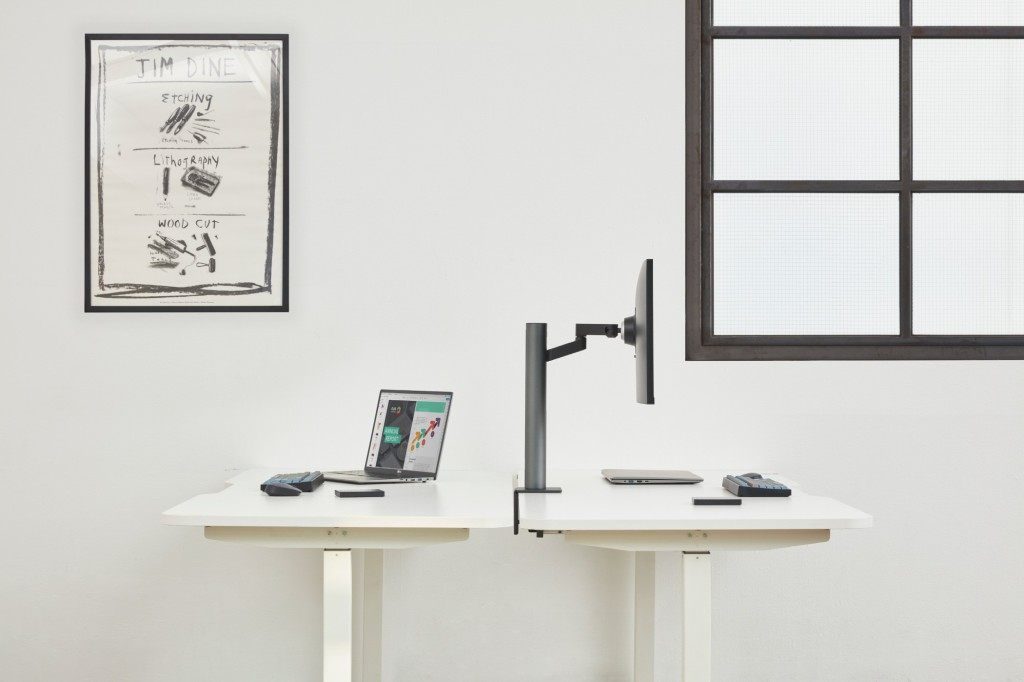 Side view of LG UltraFine Monitor 32UN880 fixed to the desk with the help of its clamp