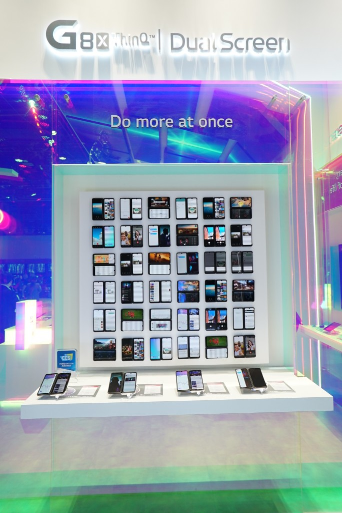 A front view of LG G8X ThinQ's and Dual Screen's main display at CES, with four devices placed in front of a large screen illustrating their limitless applications