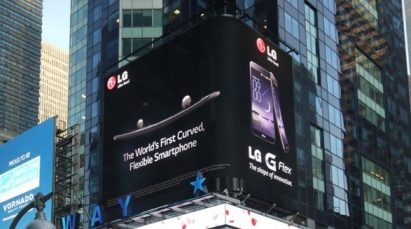 An advertisement for LG G Flex, the world's first curved flexible smartphone, in the middle of a bustling city