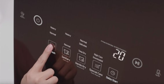 A close-up of someone pushing the Refresh button on the LG Styler's display panel to eliminate germs and bacteria from their clothes
