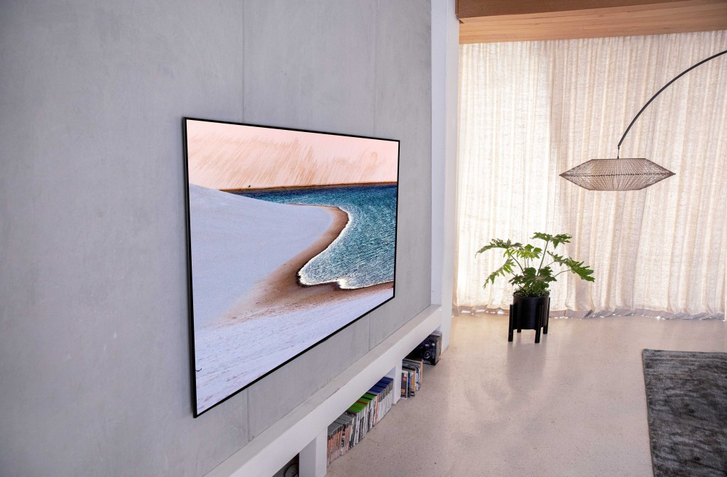 The 65-inch GX Gallery series OLED TV hanging on the wall of a modern living room