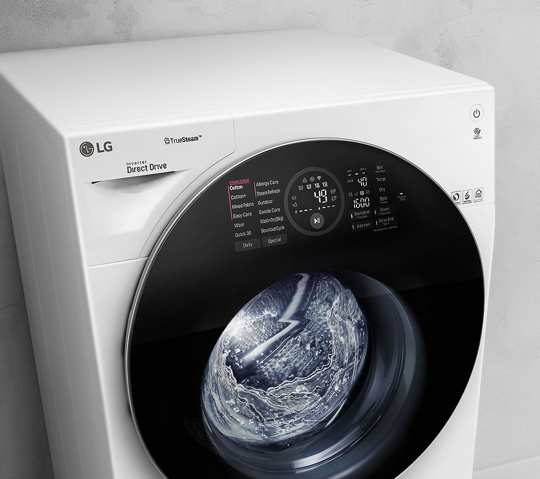 Left-side front view of the LG washing machine featuring TrueSteamTM technology as it runs a cycle