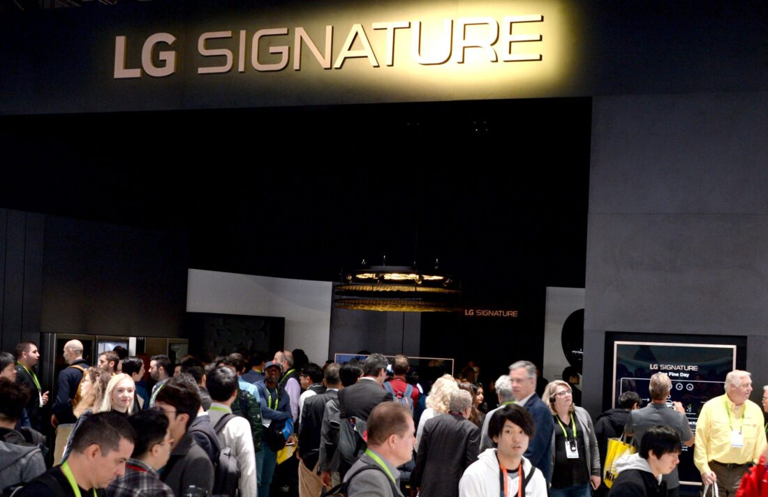 Conference attendees walk around the LG SIGNATURE display zone at CES 2019.
