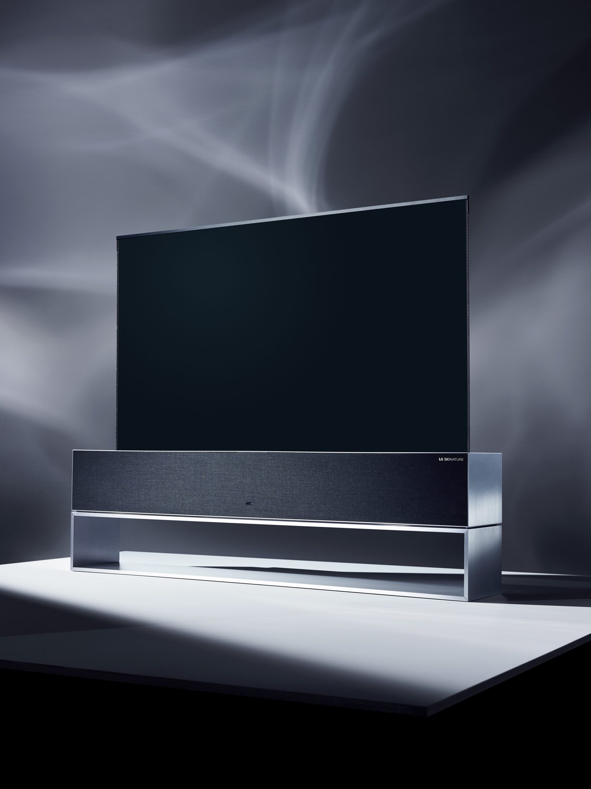 Concept image of the front LG SIGNATURE OLED TV R facing 10 degrees to the left at a darkened studio