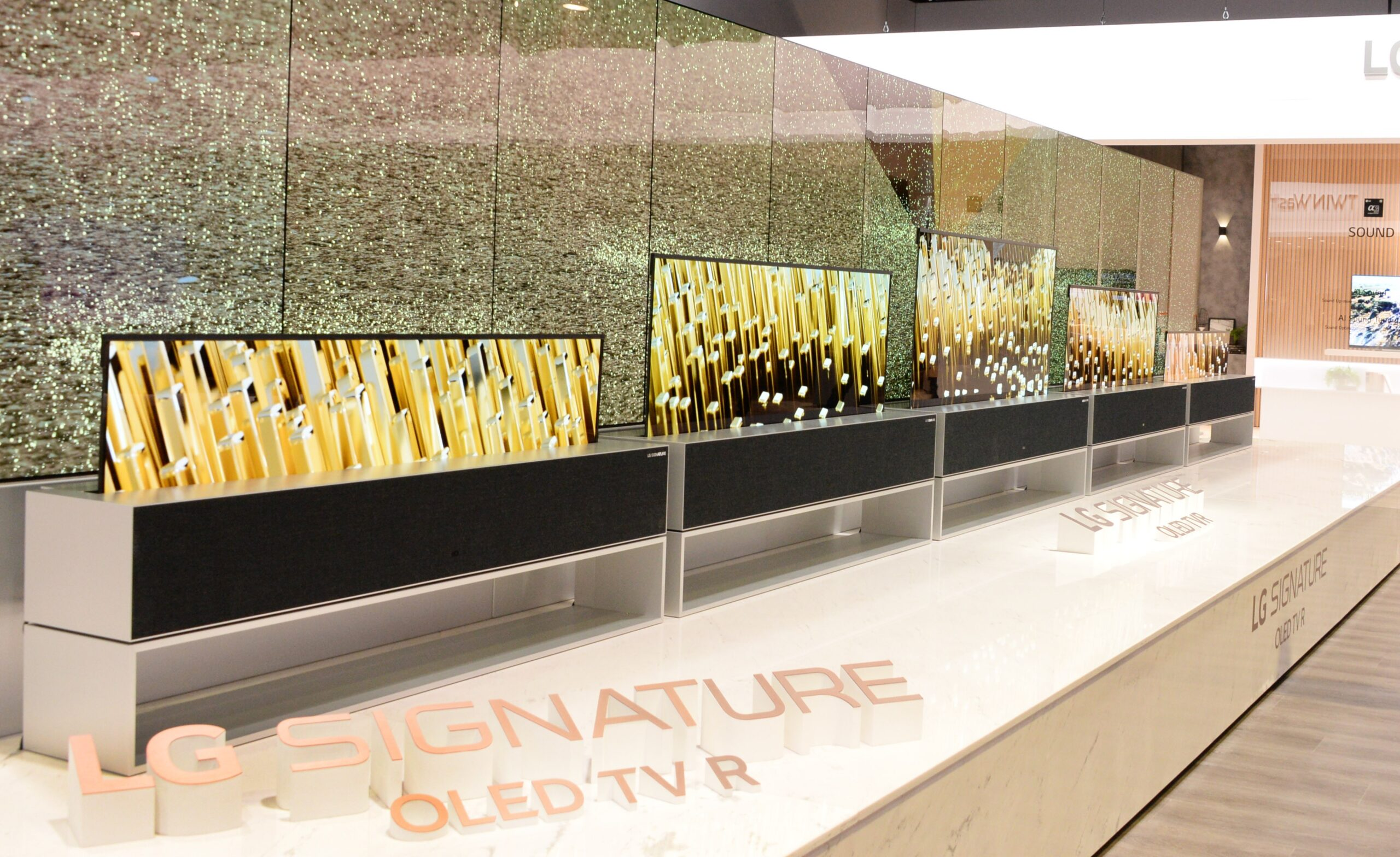 Close view of LG SIGNATURE OLED TV R display zone with the rollable OLED screen furling down into the control box
