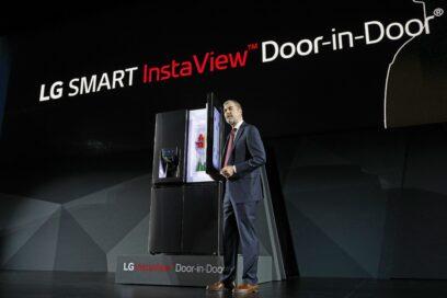 David VanderWaal, Senior Vice President, Marketing, LG Electronics opens the door of LG's InstaView Door-in-Door refrigerator at its CES 2017 Press Conference.