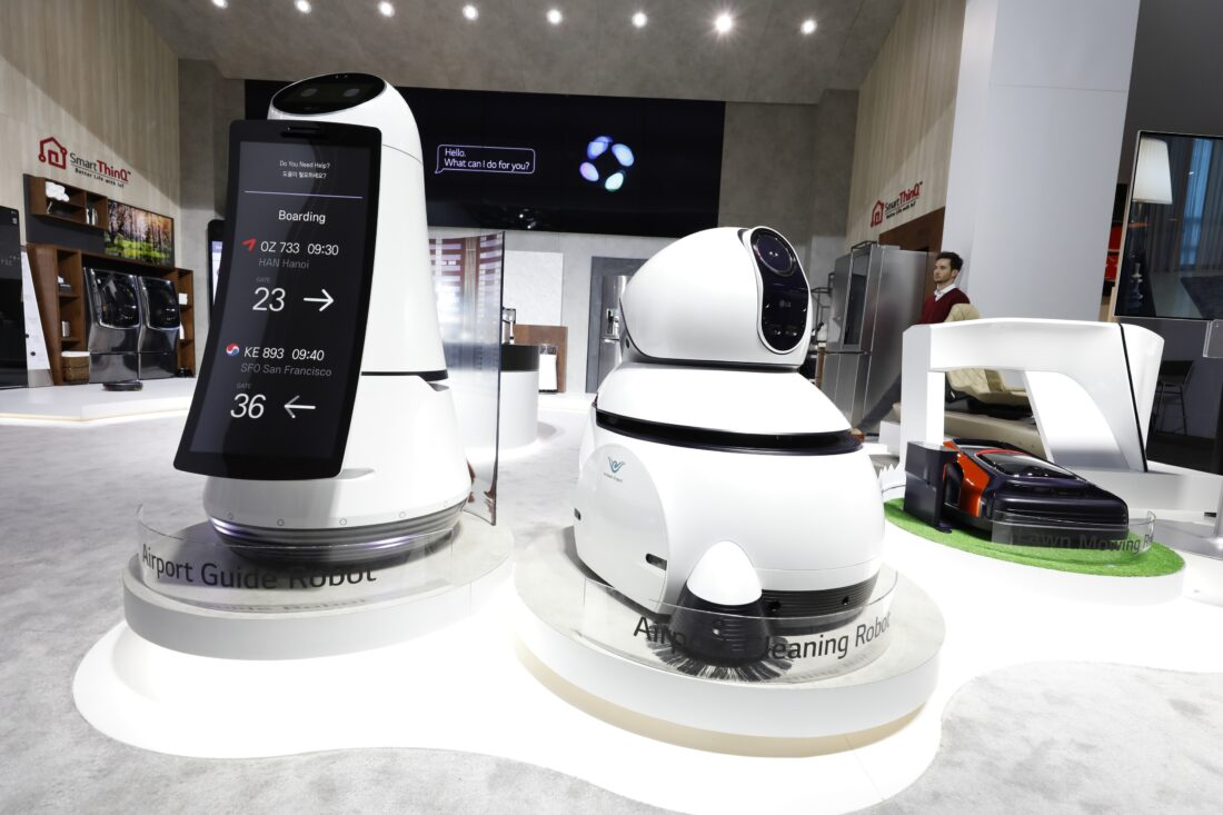 Front view of LG's commercial robots including the Airport Guide Robot, Airport Cleaning Robot and Lawn Mowing Robot at LG's CES 2017 booth