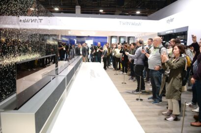 Side view of LG SIGNATURE OLED TVR display zone with CES visitors viewing the display and taking pictures