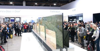 Another view of LG SIGNATURE OLED TVR display zone with CES visitors viewing the display and taking pictures
