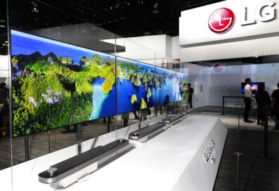 Side view of four sets of LG SIGNATURE OLED TV W placed abreast at LG's CES 2017 booth