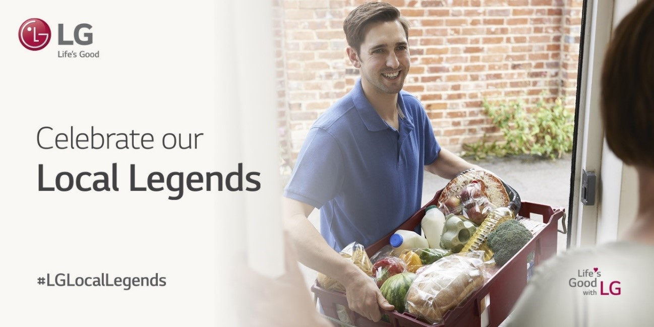"A man carries groceries into someone's house with the tagline, ""Celebrate our Local Legends', displayed on the left"
