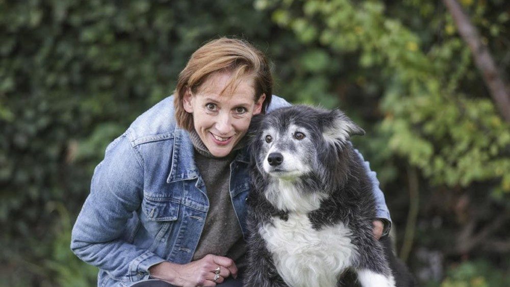 Jennifer Hunt poses with a dog that benefited from the Pet Medical Crisis Fund