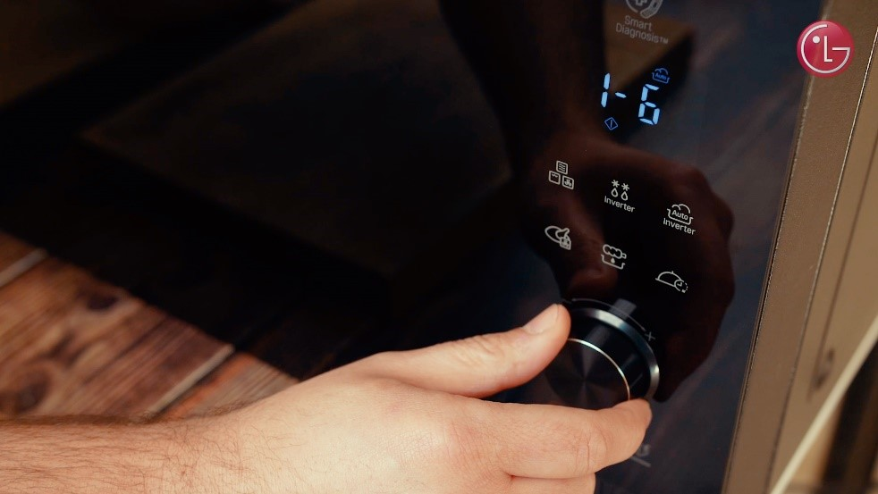 A close-up of Chef Marques using the LG NeoChef microwave oven's user interface
