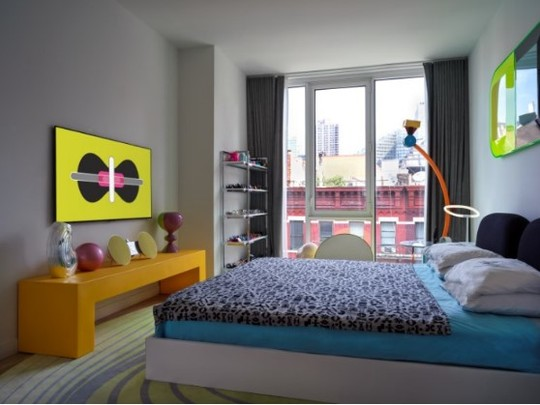 A uniquely decorated bedroom with one of LG's GALLERY DESIGN TVs displaying Karim Rashid's KARMA on the left-side wall