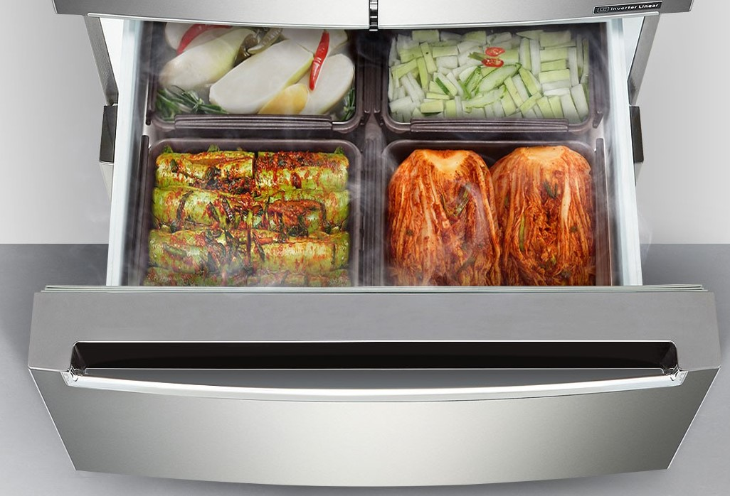 A closer look inside one of the two lower compartments of LG's kimchi refrigerator, which is storing four large boxes holding four kinds of kimchi