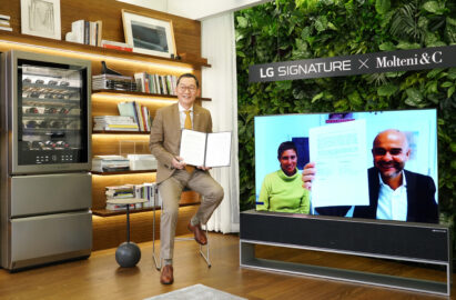 Giulia Molteni, director of marketing and communications at the Molteni Group, joins Kim Jin-hong, head of LG Electronics' Global Marketing Center, via the LG SIGNATURE OLED TV R to show off the signed papers of their new collaboration