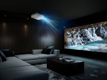 The LG CineBeam attached to the ceiling of a dark home cinema room delivers high-resolution imagery of a waterfall and the perfect movie theater experience