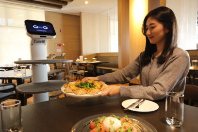 A person being served by LG ChefBot at a restaurant