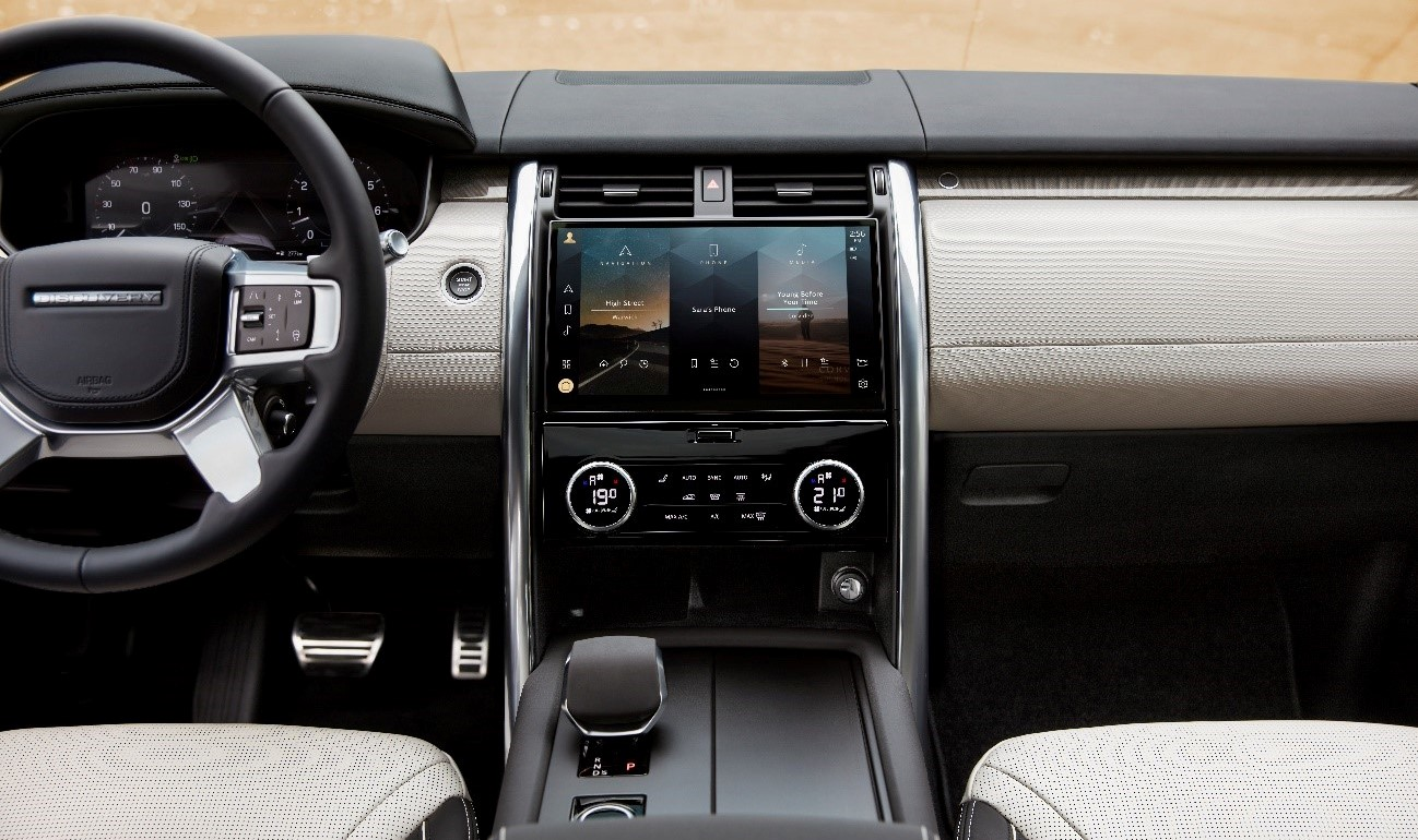 The front interior of the Land Rover Discovery model with the Pivi Pro infotainment system LG helped make