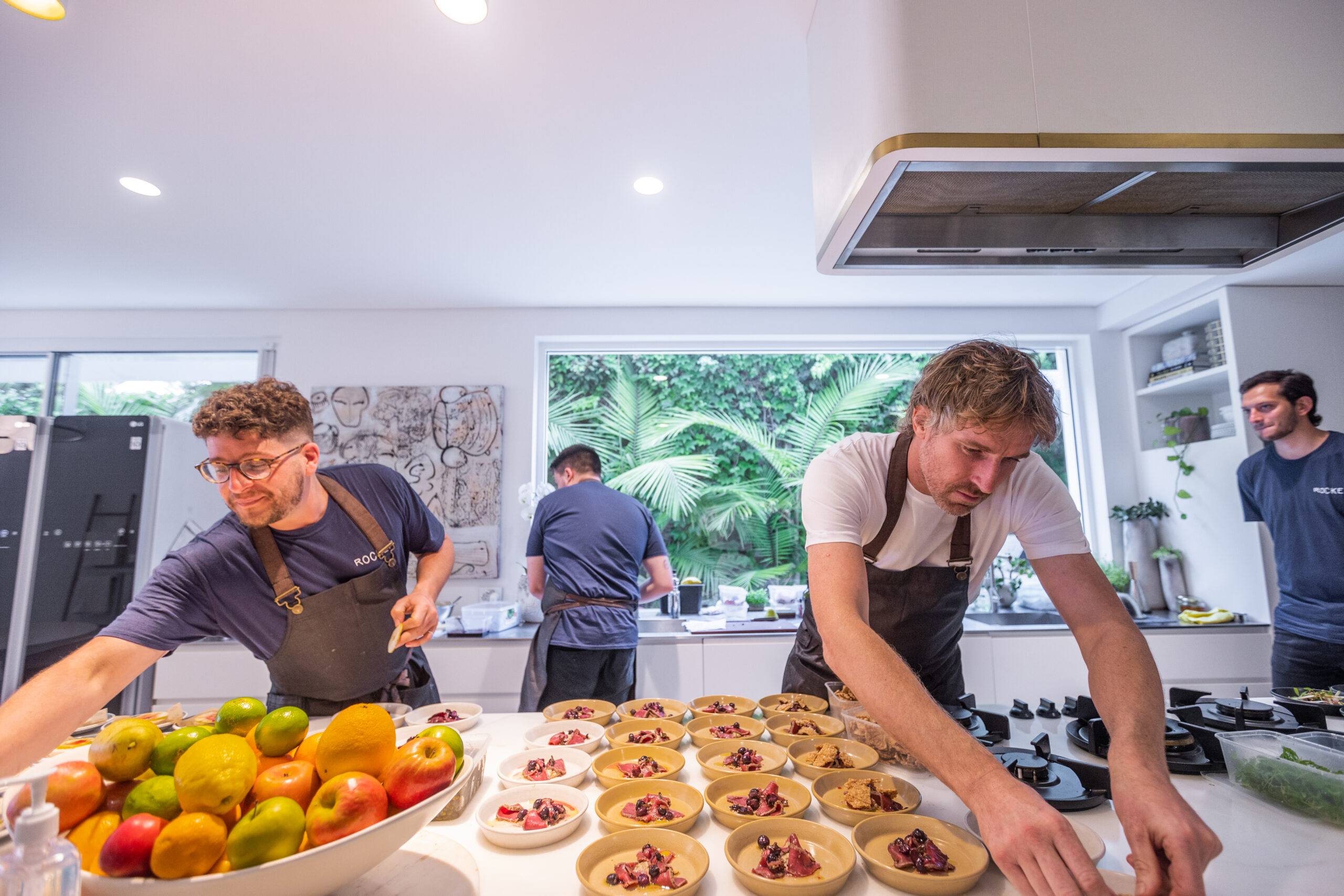 Chef Darren Robertson and members of his staff preparing fresh Australian dishes for LG's Connecting Australia campaign