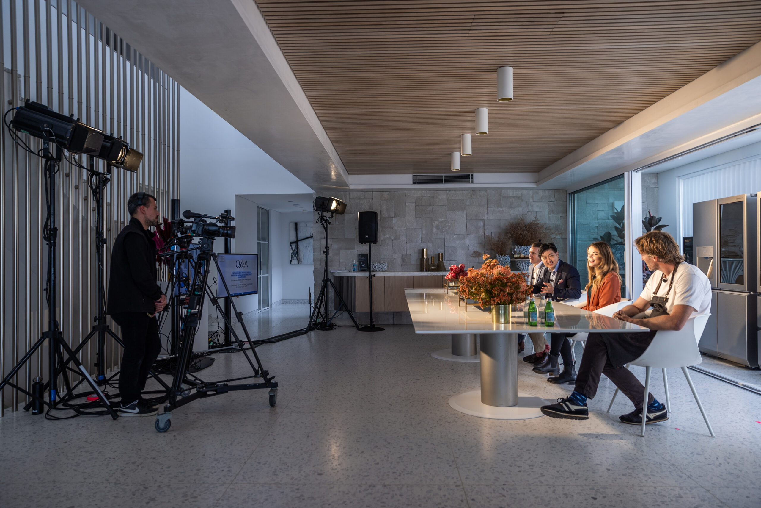 A production team filming Chef Darren Robertson and his co-hosts for the LG SIGNATURE Wine Cellar virtual launch experience in Australia
