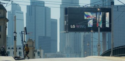 A billboard advertisement displaying the front and rear view of LG WING in Michael Bay's upcoming film, Songbird