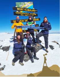 Members of FC Cambounet pose for a group photo at the peak of Mount Kilimanjaro.