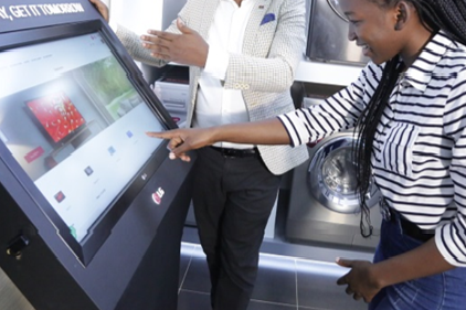 A customer browsing products on a screen at Africa's first-ever digital showroom.