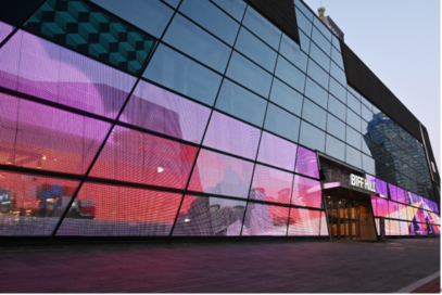 The expansive LG Transparent LED Film displaying video on the Busan Cinema Center's front, which can turn from transparent glass panes to colorful displays in an instant.