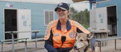Adele Jago giving an interview about her work searching for missing people as a search dog sits on her lap.