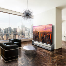 Earth meets metal in this luxurious living space, fusing the unique, high-end characteristics of the Marron Emperador marble floor with the cool steel of the OLED TV's Art Furniture Stand. The 8K resolution of the OLED TV blended with the natural elements of the smooth marble floor giving out the perfect juxtaposition to LG SIGNATURE's technology, offering a superior viewing experience.