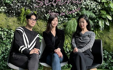 Three members of the Visual Identity team posing in front of greenery at the LG R&D Campus' Salon de Seocho.